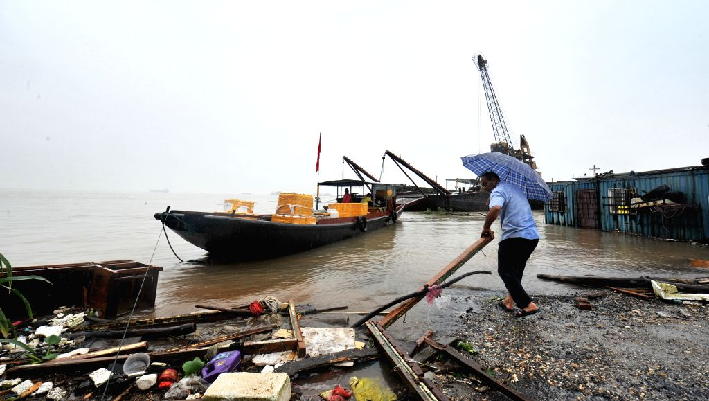 YUEYANG, July 4, 2016 - A ship is seen on the water near Dongting Lake Bridge in Yueyang, central China's Hunan Province, on July 4, 2016.  More torrential rain is expected Monday in Hunan Province, ...