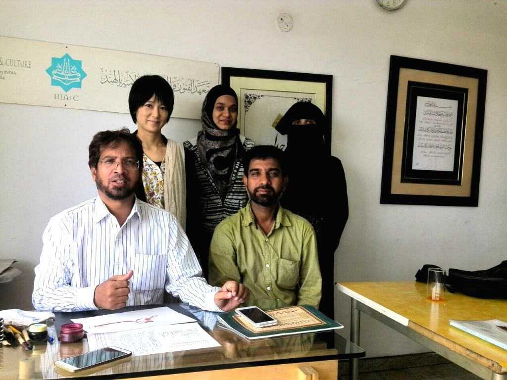 Yuko Takaji with her teacher Muqtar Ahmed (Left-sitting) with other students at Bengaluru institute.