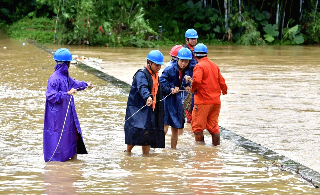 YULIN, Sept. 17, 2018 - Workers try to recover power supply in Pingpo Village of Longsheng Township, south China's Guangxi Zhuang Autonomous Region, Sept. 17, 2018. Super Typhoon Mangkhut ravaged ...