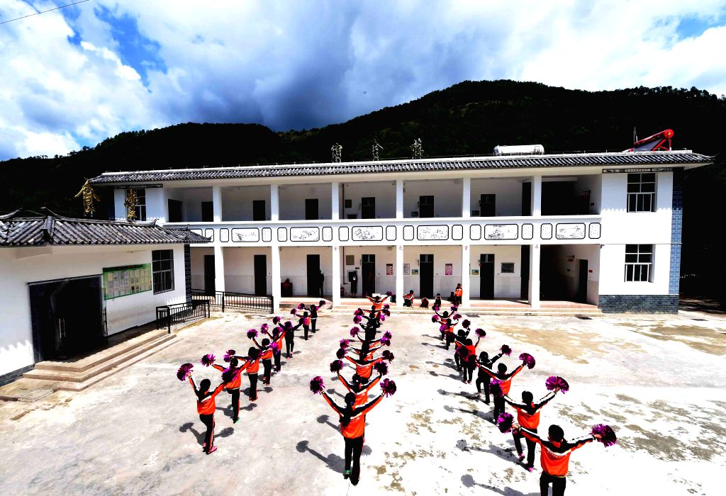 YUNLONG, May 25, 2017 - Pupils do exercises at Henan Primary School in Tuanjie Township of Yi ethnic group in Yunlong County, southwest China's Yunnan Province, May 19, 2017. The primary school was ...