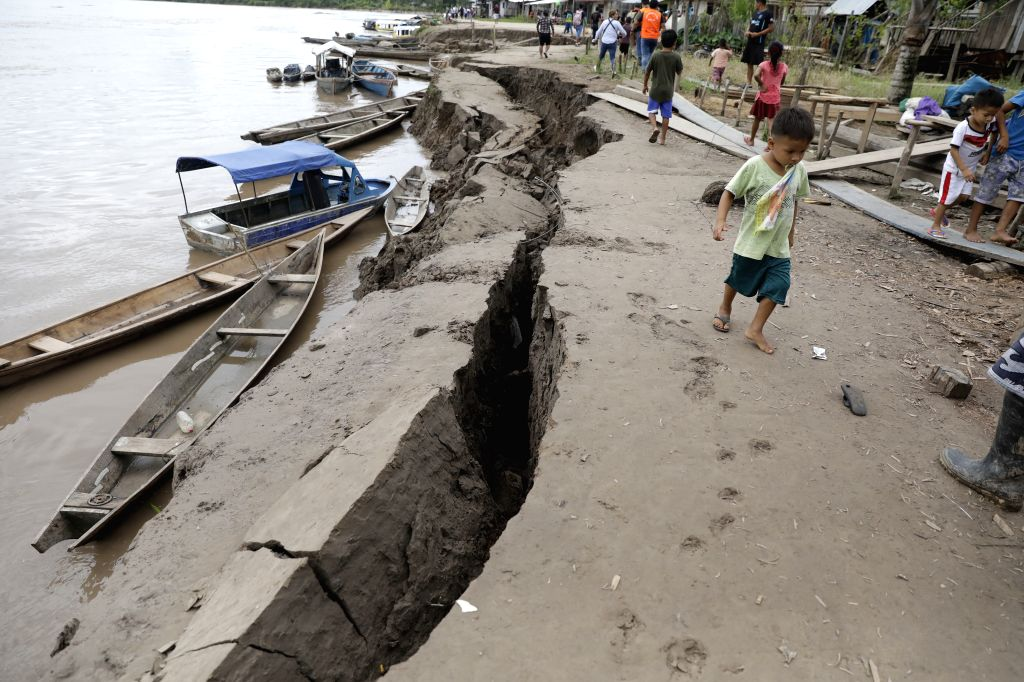 YURIMAGUAS, May 27, 2019 - A boy walks in the area affected by an earthquake in the port of Santa Gema, Yurimaguas of Peru, on May 26, 2019. An earthquake with a preliminary magnitude of  8.0 stuck ...