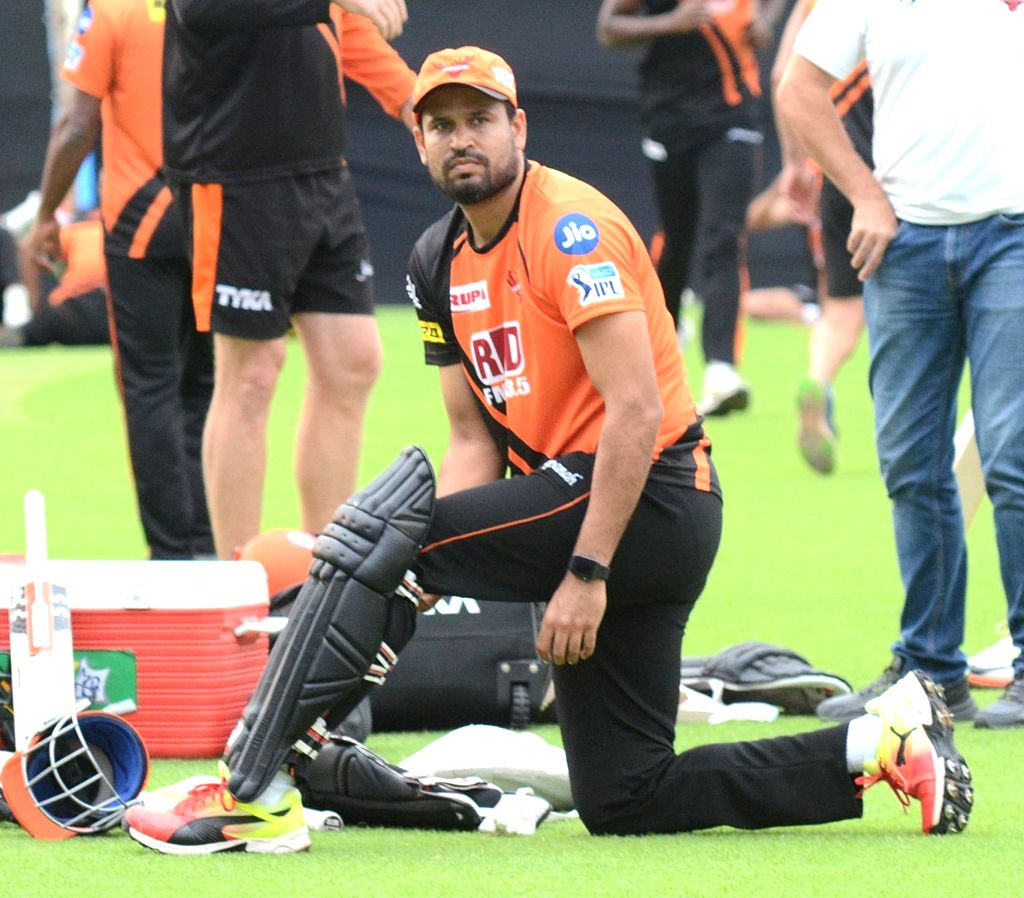 Yusuf Pathan of Sunrisers Hyderabad (SRH) Tom Moody and mentor VVS Laxman during a practice session, at the Eden Gardens in Kolkata on May 24, 2018.
