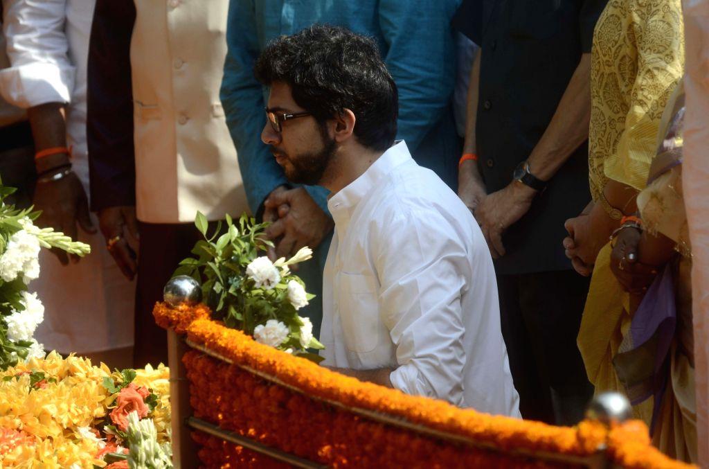 Yuva Sena chief Aditya Thackeray pays tribute to Shiv Sena founder Balasaheb Thackeray on his death anniversary at Balasaheb Thackeray memorial in Shivaji Park of Mumbai, on Nov. 17, 2015.