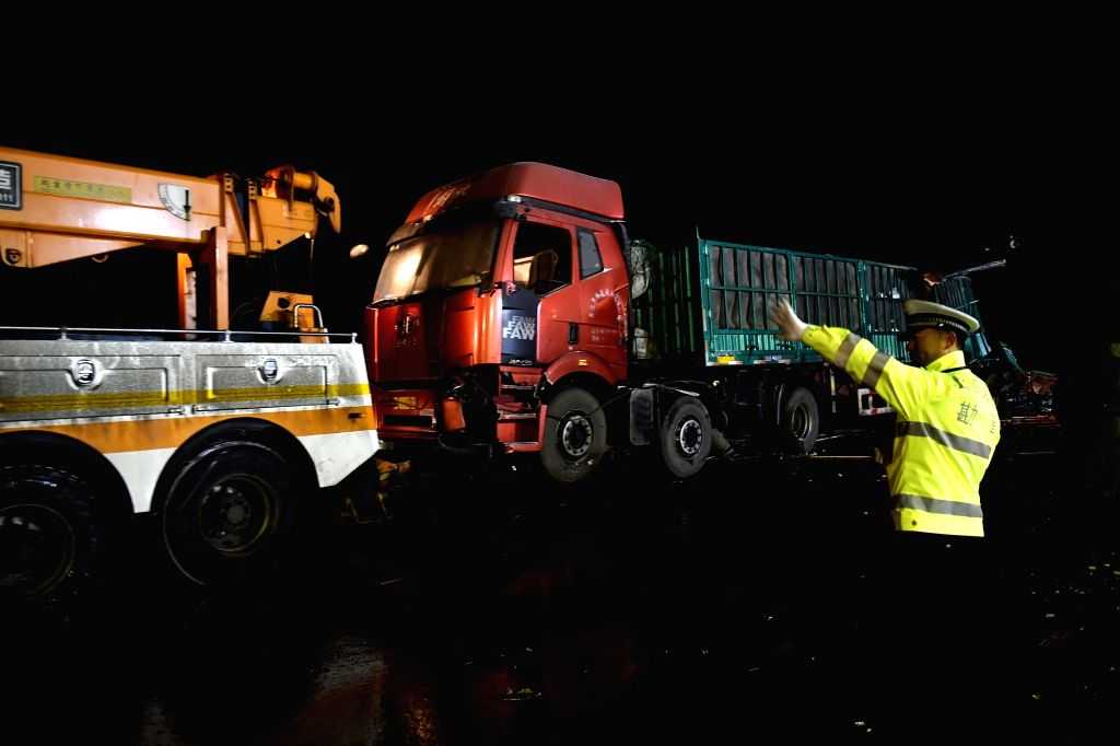 YUXIAN, Nov. 22, 2016 - Photo taken on Nov. 21, 2016 shows the accident scene on the Pingyang section of Beijing-Kunming expressway in north China's Shanxi Province. A total of 17 people died and 37 ...