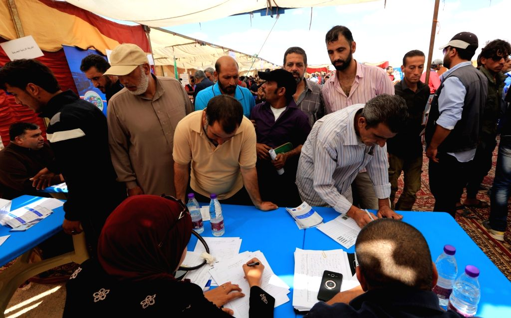 ZAATARI (JORDAN), Oct. 4, 2017 Syrian refugees register in the office for employment at Zaatari refugee camp, Jordan, on Oct. 4, 2017. The office is set up by UNHCR, the UN Refugee ...
