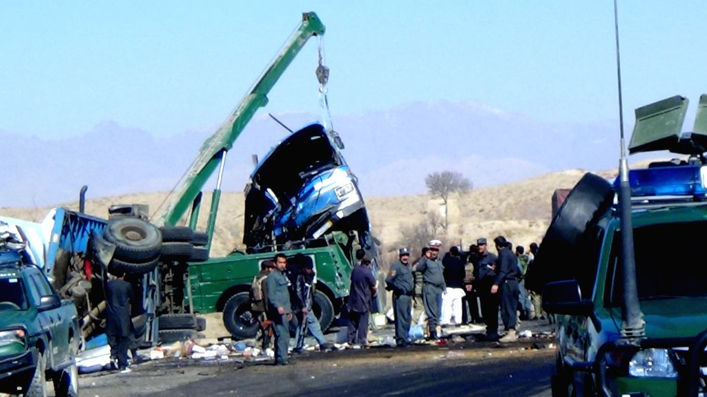 A destroyed bus is transferred after it collided with a truck in Zabul province in southern Afghanistan on Jan. 29, 2015. At least 21 people were killed and more than