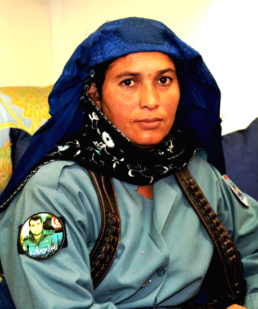 ZABUL, Nov. 29, 2016 - An Afghan female police officer poses for a photo inside her office in Qalat city, capital of southern Afghanistan's Zabul province, Nov. 21, 2016. A polygamist police officer ...