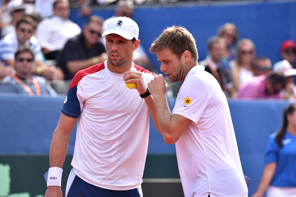ZADAR, Sept. 16, 2018 - Mike Bryan (L) and Ryan Harrison of the United States react during Davis Cup semifinal doubles match against Mate Pavic and Ivan Dodig of Croatia in Zadar, Croatia, Sept. 15, ...