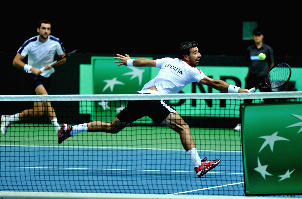 ZADAR, Sept. 18, 2016 - Croatia's Ivan Dodig (R) and Marin Cilic compete during a Davis Cup World Group semi-final doubles match against France's Pierre-Hugues Herbert and Nicolas Mahut in Zadar, ...