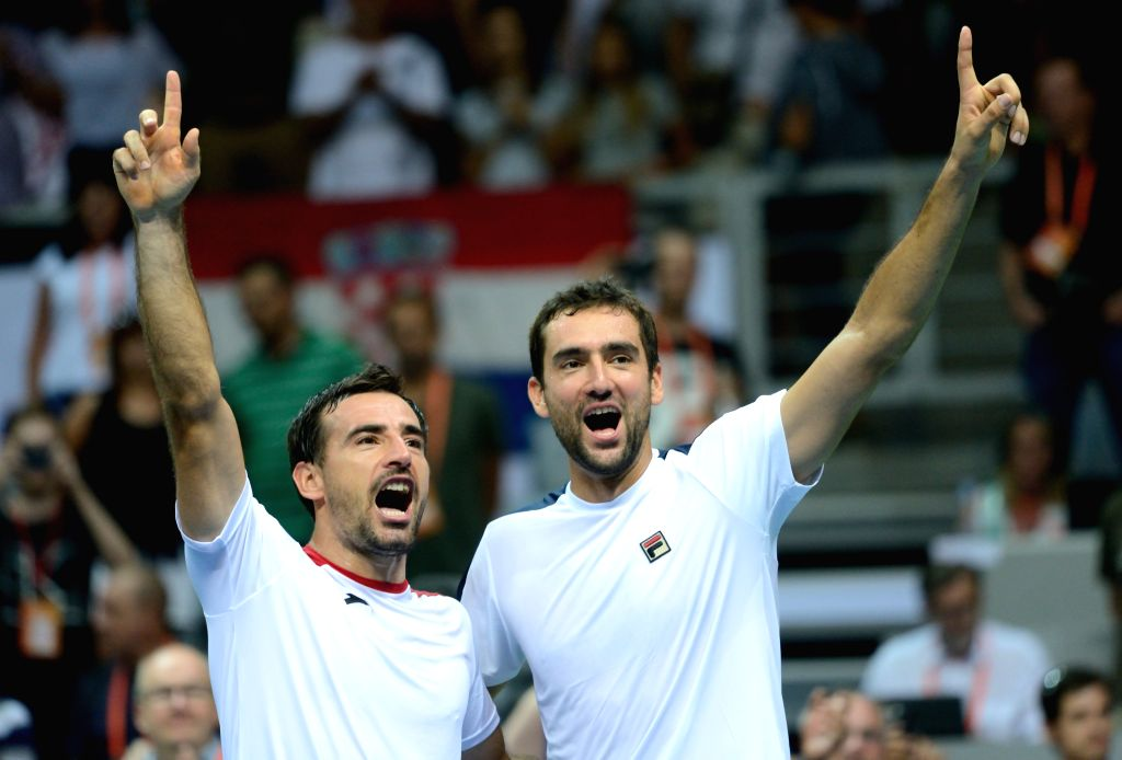 ZADAR, Sept. 18, 2016 - Croatia's Marin Cilic (R) and Ivan Dodig celebrate after winning a Davis Cup World Group semi-final doubles match against France's Pierre-Hugues Herbert and Nicolas Mahut in ...