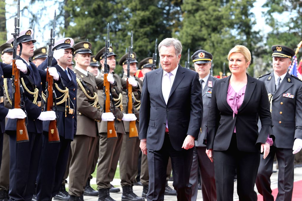 ZAGREB, April 10, 2018 - Visiting Finnish President Sauli Niinisto (L Front) and Croatian President Kolinda Grabar-Kitarovic (R Front) inspect the guard of honor during a welcoming ceremony in front ...