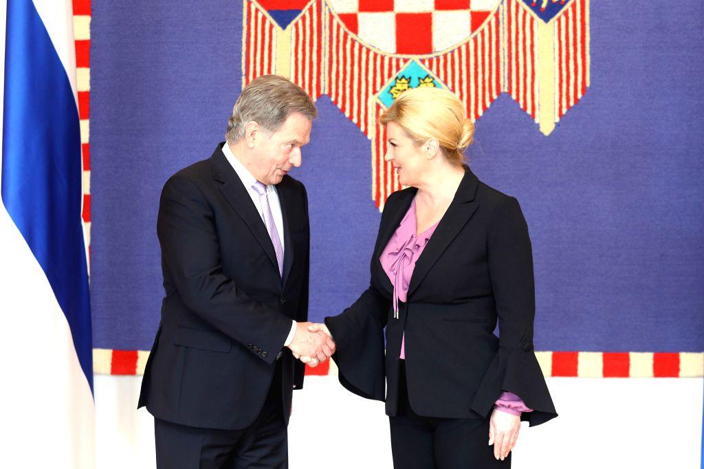 ZAGREB, April 10, 2018 - Visiting Finnish President Sauli Niinisto (L) shakes hands with Croatian President Kolinda Grabar-Kitarovic during a meeting at the Presidential Palace in Zagreb, capital of ...