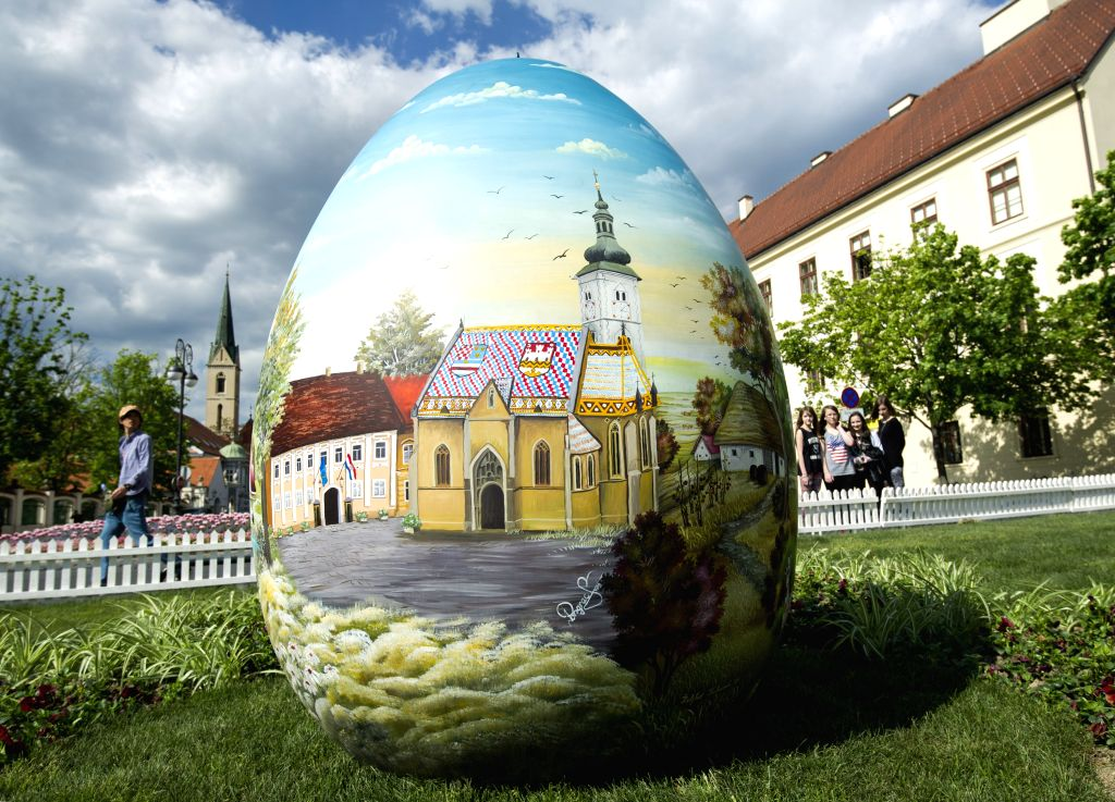 Photo taken on April 14, 2014 shows a huge hand-painted Easter egg on display near the Zagreb Cathedral on Kaptol in Zagreb, capital of Croatia, April 14, 2014. ...