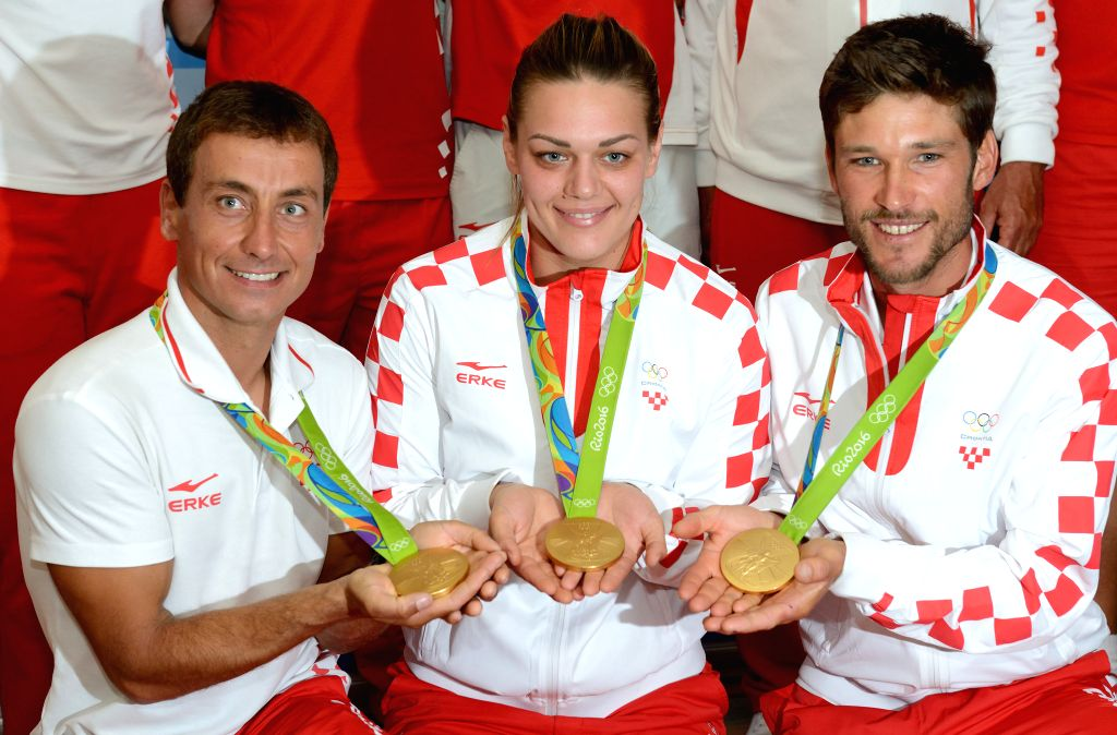 ZAGREB, August 21, 2016 - Croatia's Sandra Perkovic (C), Sime Fantela (R) and Igor Marenic show their gold medals during the official welcoming ceremony at the Pleso Airport in Zagreb, capital of ...