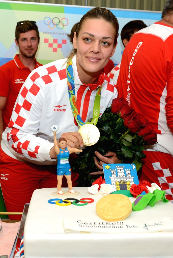ZAGREB, August 21, 2016 - Sandra Perkovic of Croatia shows her gold medal during the official welcoming ceremony at the Pleso Airport in Zagreb, capital of Croatia, August 20, 2016. Sandra Perkovic, ...
