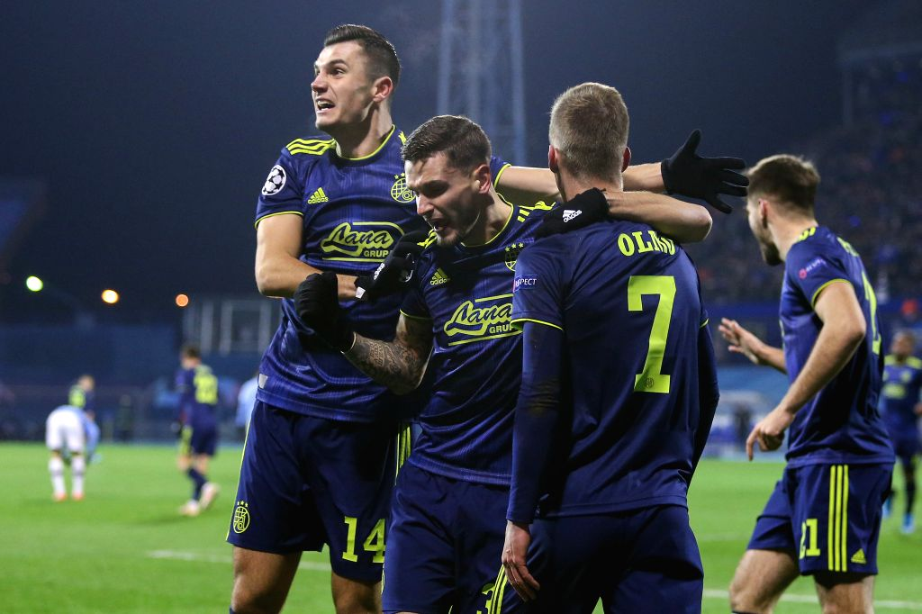 ZAGREB, Dec. 12, 2019 - Dani Olmo (front R) of Dinamo Zagreb celebrates with teammates after scoring a goal during a Group C match of the 2019-2020 UEFA Champions League between Dinamo Zagreb and ...