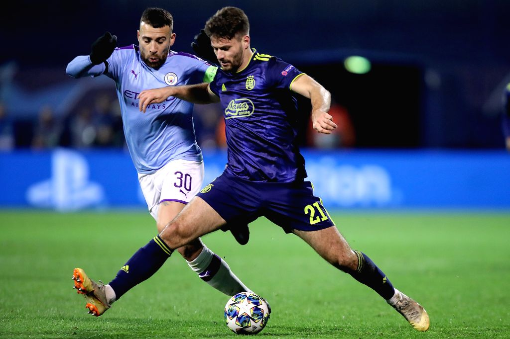 ZAGREB, Dec. 12, 2019 - Nicholas Otamendi (L) of Manchester City vies with Bruno Petkovic of Dinamo Zagreb during a Group C match of the 2019-2020 UEFA Champions League between Dinamo Zagreb and ...