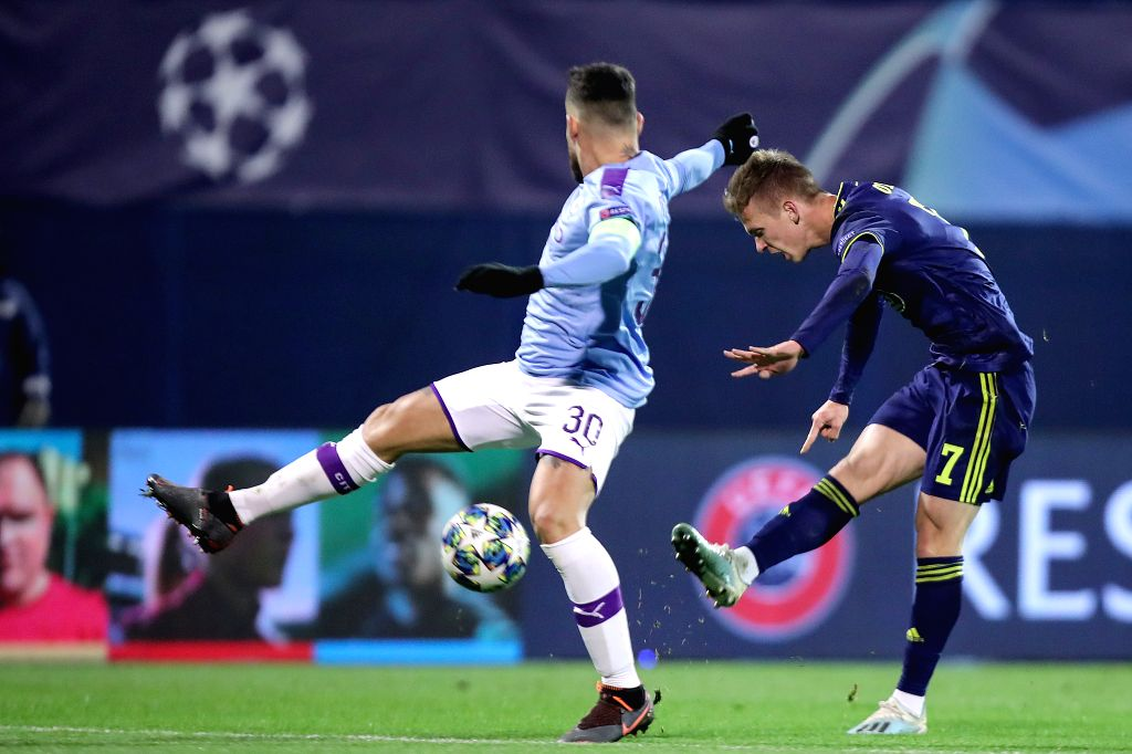 ZAGREB, Dec. 12, 2019 - Nicholas Otamendi (L) of Manchester City vies with Dani Olmo of Dinamo Zagreb during a Group C match of the 2019-2020 UEFA Champions League between Dinamo Zagreb and ...