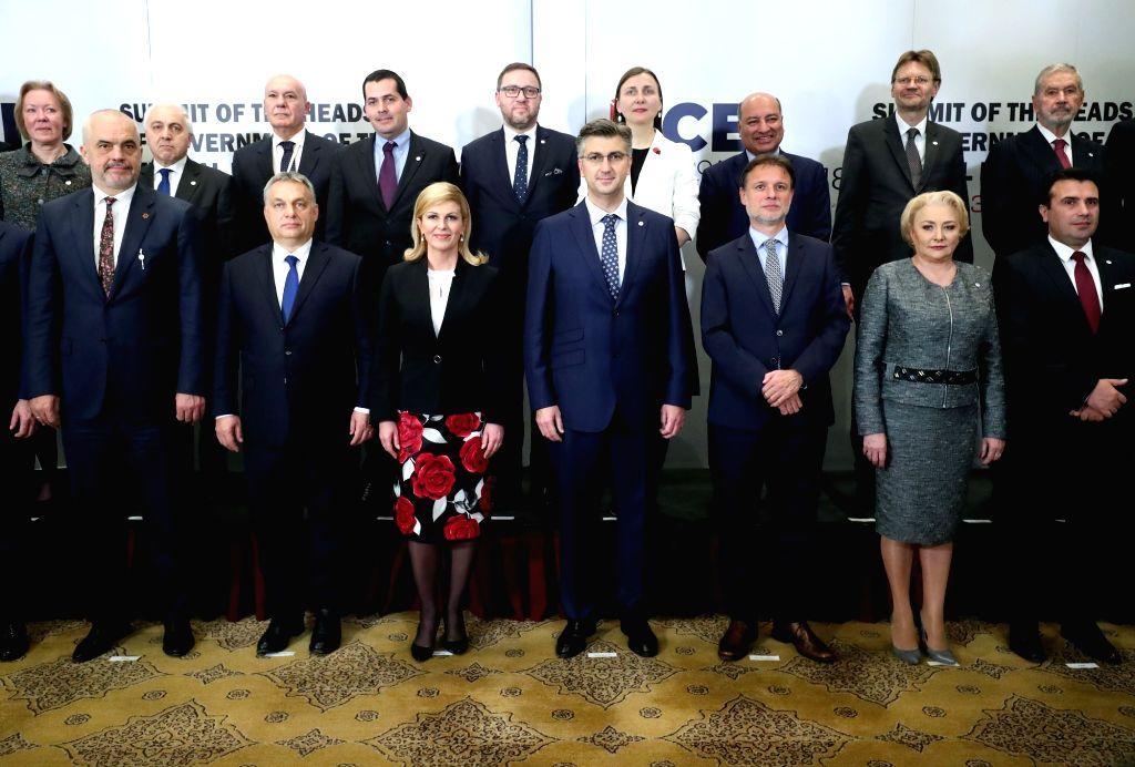ZAGREB, Dec. 3, 2018 - Croatian President Kolinda Grabar-Kitarovic (front, 3rd L), Croatian Prime Minister Andrej Plenkovic (front, 4th L) and Speaker of Croatian Parliament Gordan Jandrokovic ... - Andrej Plenkovic