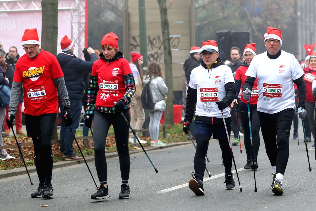 ZAGREB, Dec. 8, 2019 - Participants dressed as Santa Claus take part in the Zagreb Advent Run in Zagreb, Croatia, Dec. 8, 2019. The fourth edition of the charity race Zagreb Advent Run kicked off ...