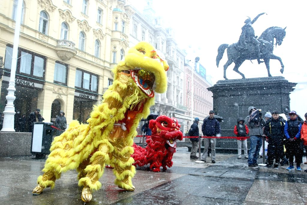 ZAGREB, Feb. 13, 2018 - Performers perform lion dance at Ban Josip Jelacic square during a celebration of the Chinese New Year in Zagreb, Croatia, on Feb. 12, 2018.