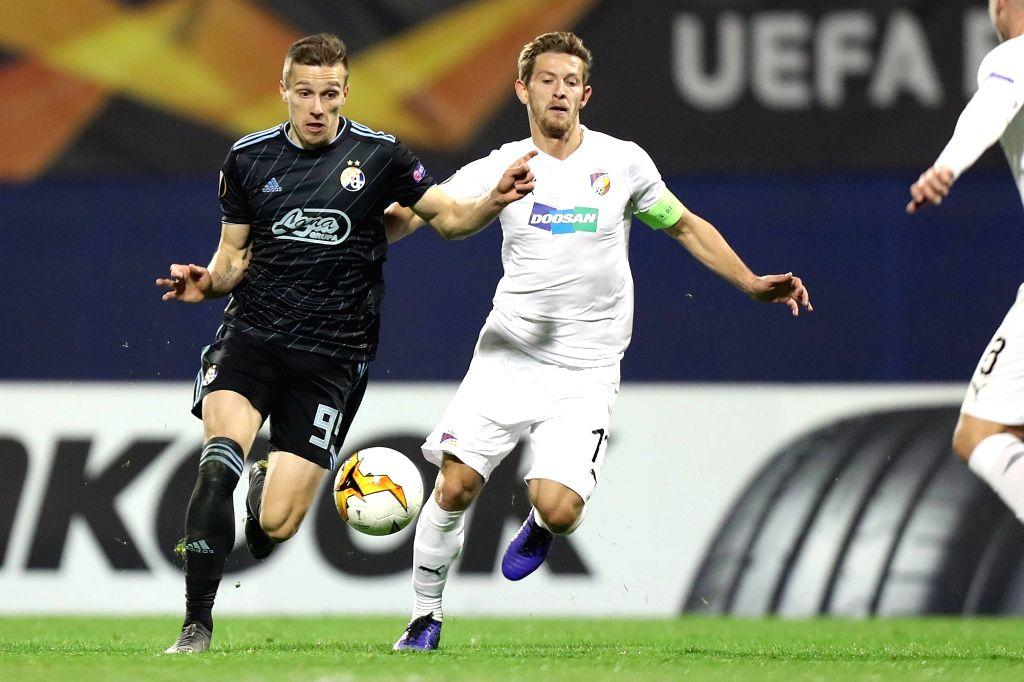 ZAGREB, Feb. 22, 2019 - GNK Dinamo Zagreb's Dani Olmo (2nd L) vies with FC Viktoria Plzen's Roman Prochazka (3rd L) during UEFA Europa League round 32 second leg match in Zagreb, Croatia, Feb. 21, ...