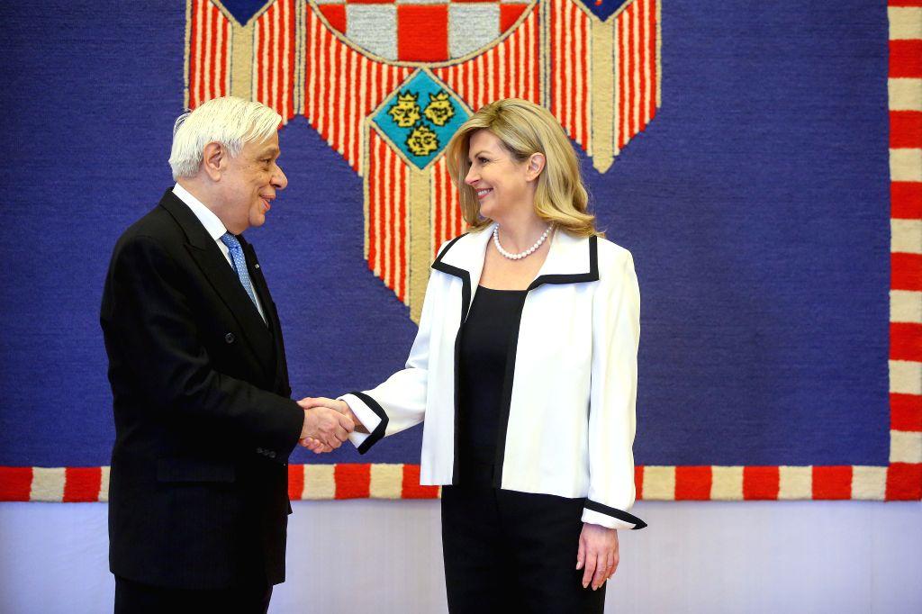 ZAGREB, Feb. 5, 2019 - Croatian President Kolinda Grabar-Kitarovic (R) meets with visiting Greek President Prokopis Pavlopoulos in Zagreb, Croatia, Feb. 5, 2019.