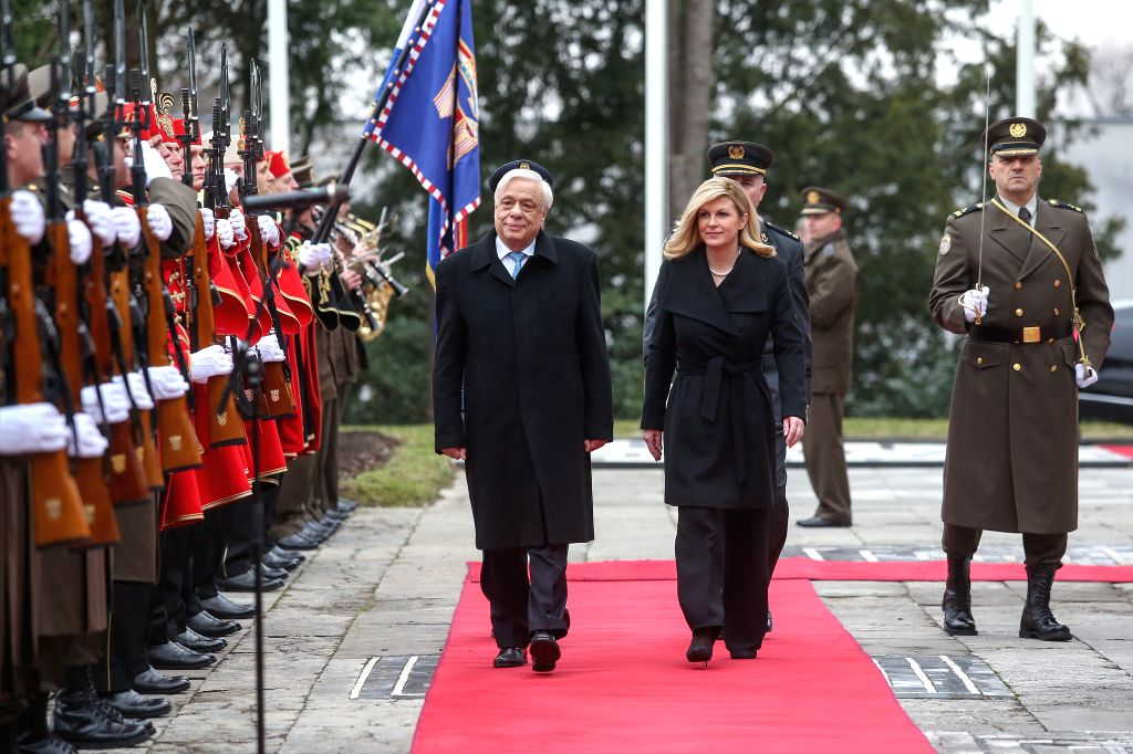 ZAGREB, Feb. 5, 2019 - Croatian President Kolinda Grabar-Kitarovic (R) and visiting Greek President Prokopis Pavlopoulos review honor guards in Zagreb, Croatia, Feb. 5, 2019.