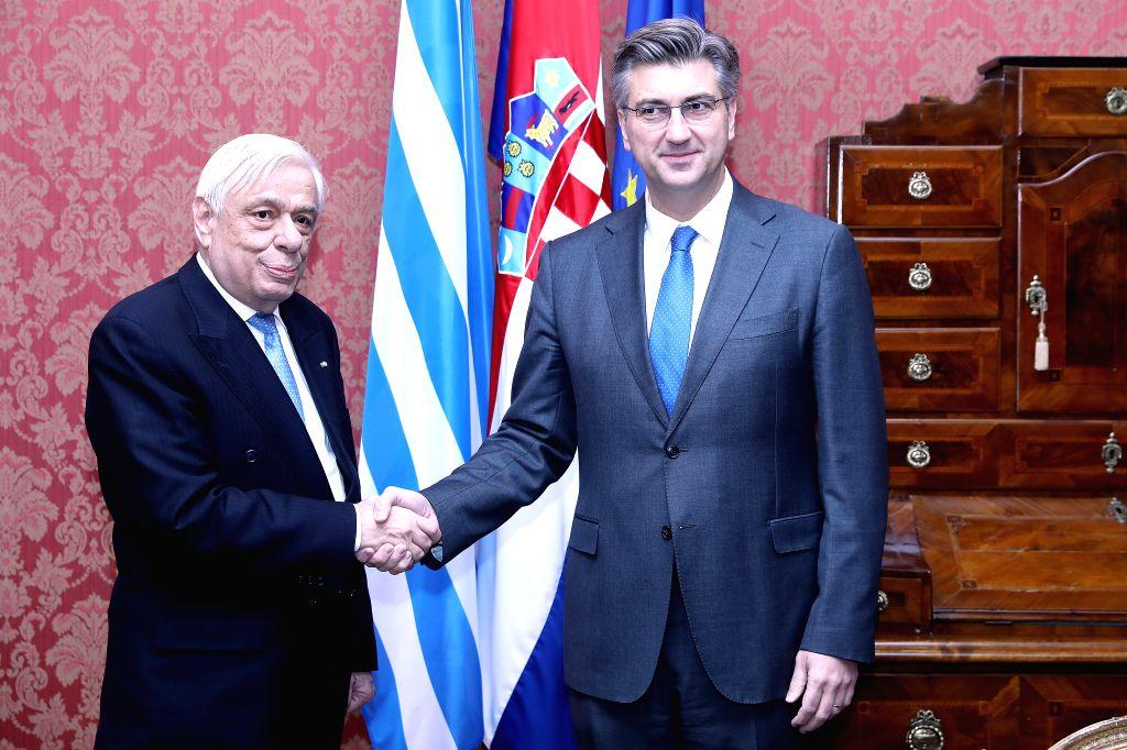 ZAGREB, Feb. 5, 2019 - Croatian Prime Minister Andrej Plenkovic (R) meets with visiting Greek President Prokopis Pavlopoulos in Zagreb, Croatia, Feb. 5, 2019. - Andrej Plenkovic