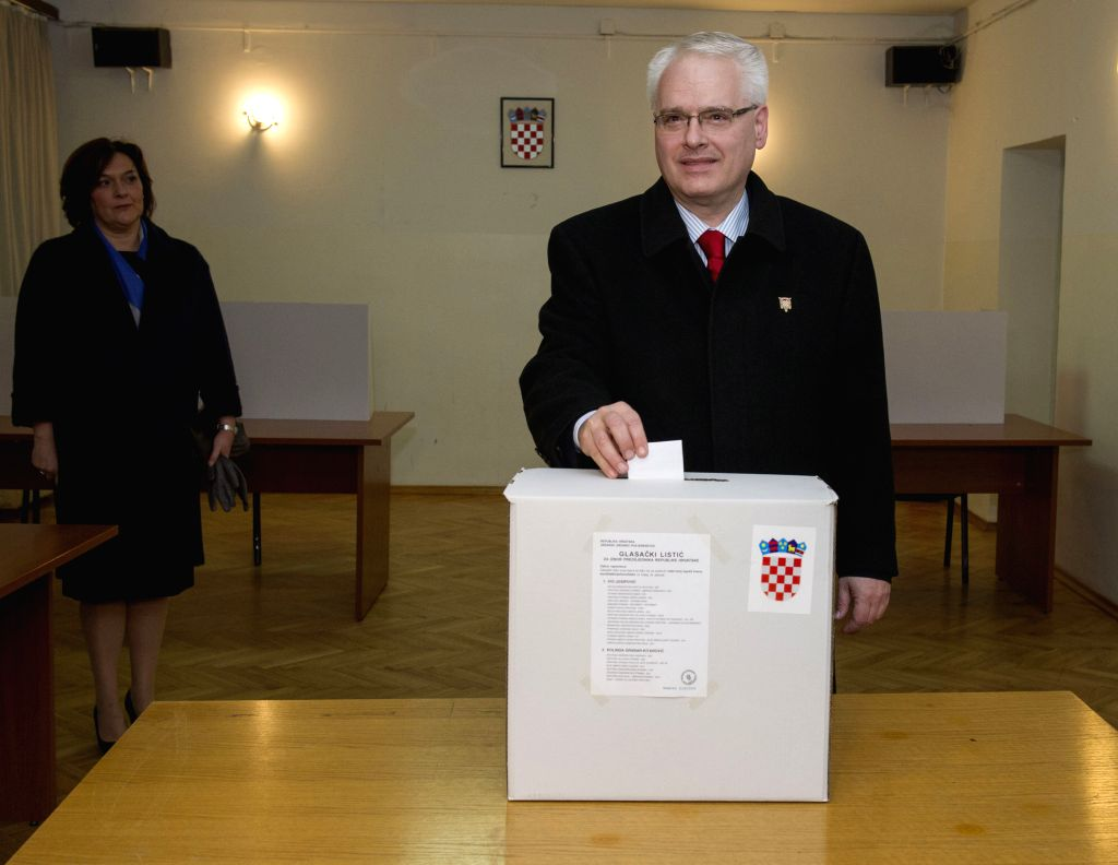 Incumbent President of Croatia Ivo Josipovic casts his vote at a polling station in Zagreb, capital of Croatia, January 11, 2015. Croatia's presidential elections ...