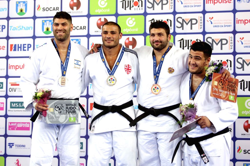 ZAGREB, July 30, 2018 - Gold medalist Guram Tushishvil (2nd L) of Georgia, silver medalist Or Sasson (1st L) of Israel, bronze medalists Inal Tasoev (2nd R) of Russia and Yakiv Khammo of Ukraine pose ...