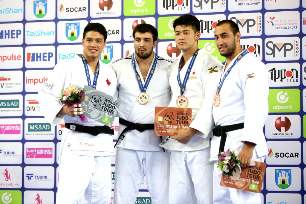 ZAGREB, July 30, 2018 - Gold medalist Niyaz Ilyasov (2nd L) of Russia, silver medalist Kyle Reyes (1st L) of Canada, bronze medalists Kentaro Iida (2nd R) of Japan and Lasha Taveluri of Georgia pose ...