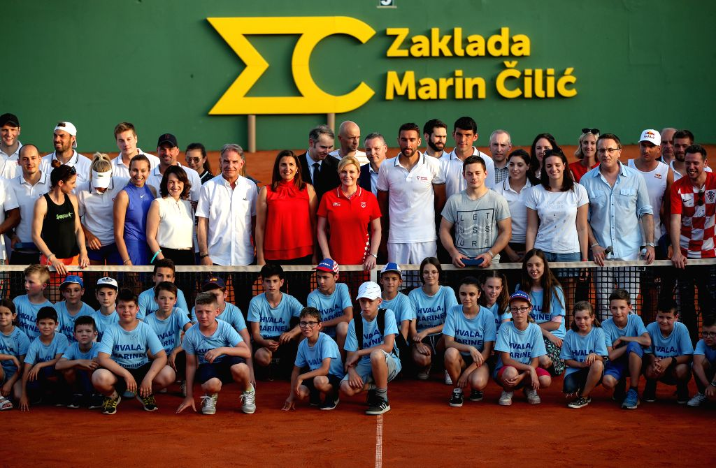 ZAGREB, June 13, 2019 - Croatian President Kolinda Grabar-Kitarovic (C) poses for a group photo with participants of Gem Set Croatia, a humanitarian sports event organized by the Marin Cilic ...