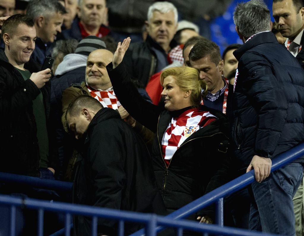 Croatian President Kolinda Grabar-Kitarovic wave to the audience after the UEFA Euro 2016 Group H qualifying match between Croatia and Norway at Maksimir stadium in ...
