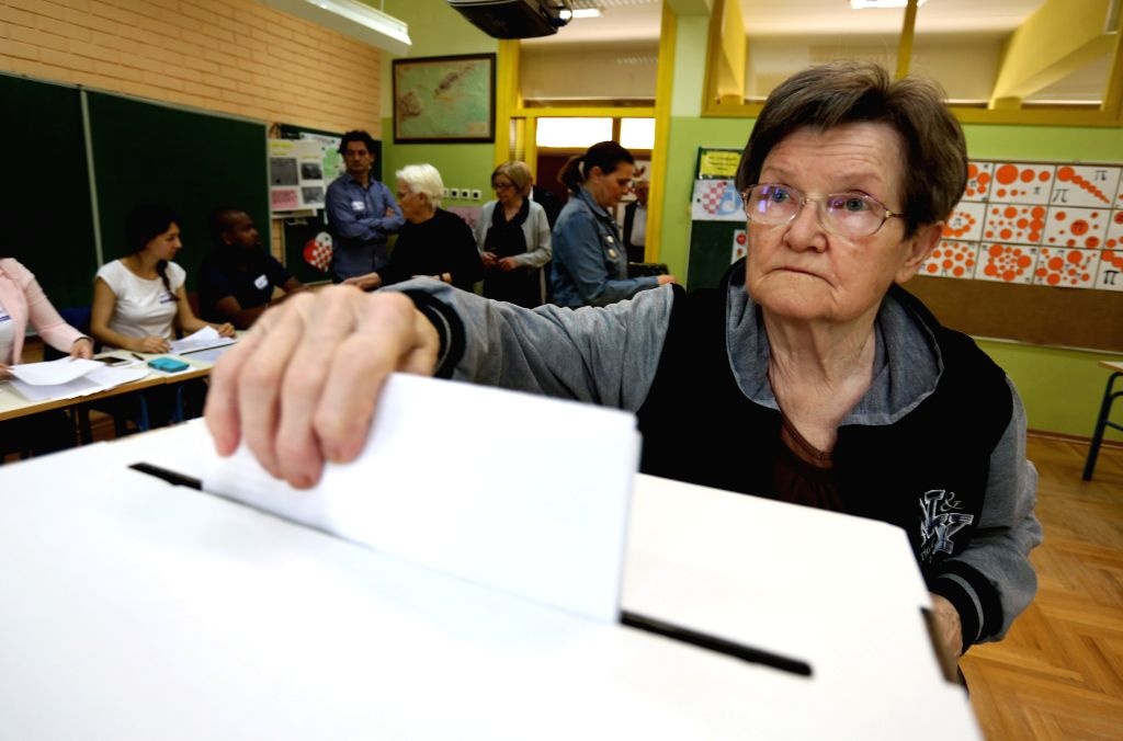 ZAGREB, May 26, 2019 - A woman casts her vote at a polling station in Zagreb, Croatia, May 26, 2019. The European Parliament elections started in Croatia on Sunday.