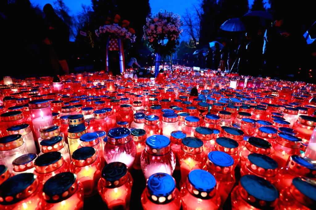ZAGREB, Nov. 1, 2018 - Candles are lit for the deceased at Mirogoj Cemetery in Zagreb, Croatia, on Nov. 1, 2018. Croatian people gathered at cemeteries around the country to honor their late ...