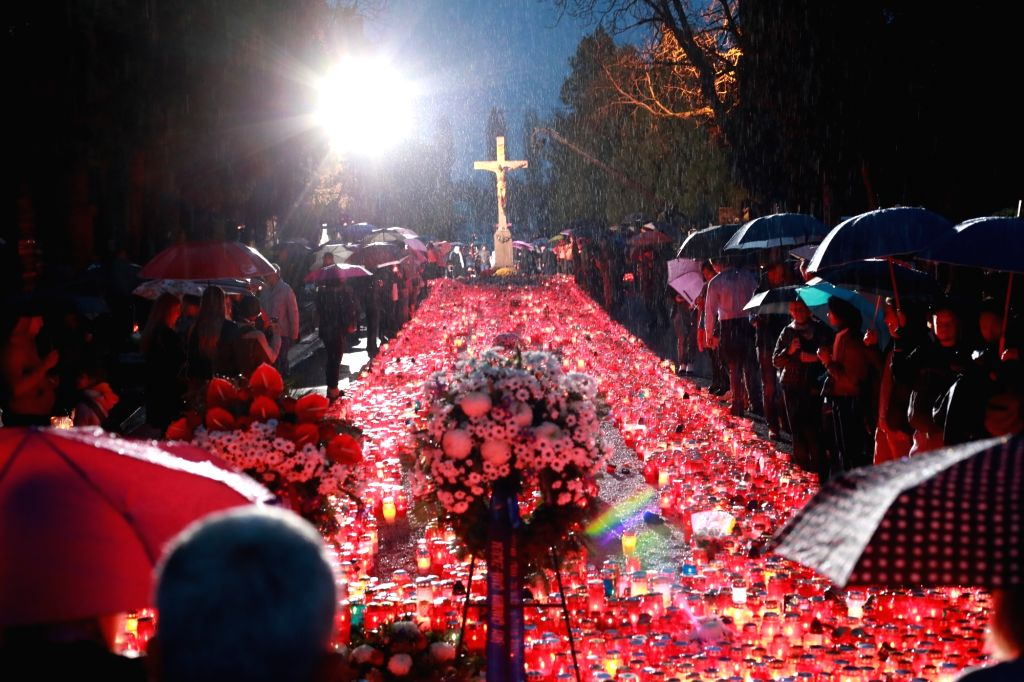 ZAGREB, Nov. 1, 2018 - People pay their respects to the deceased at Mirogoj Cemetery in Zagreb, Croatia, on Nov. 1, 2018. Croatian people gathered at cemeteries around the country to honor their late ...