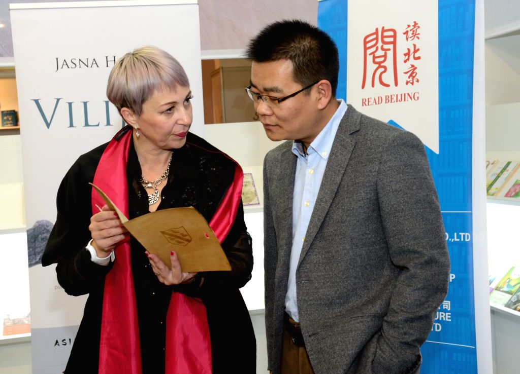 ZAGREB, Nov. 13, 2016 - Chinese writer Xu Zechen (R) talks with Croatian writer Jasna Horvat at the 39th International Book Fair in Zagreb, Croatia, Nov. 12, 2016. The six-day fair, which kicked off ...