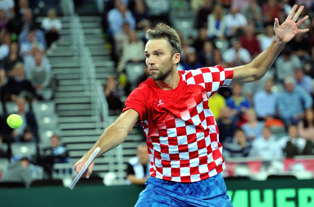 ZAGREB, Nov. 26, 2016 - Ivo Karlovic of Croatia returns the shot during the Davis Cup World Group final singles match against Juan Martin Del Potro of Argentina in Zagreb, capital of Croatia, Nov. ...
