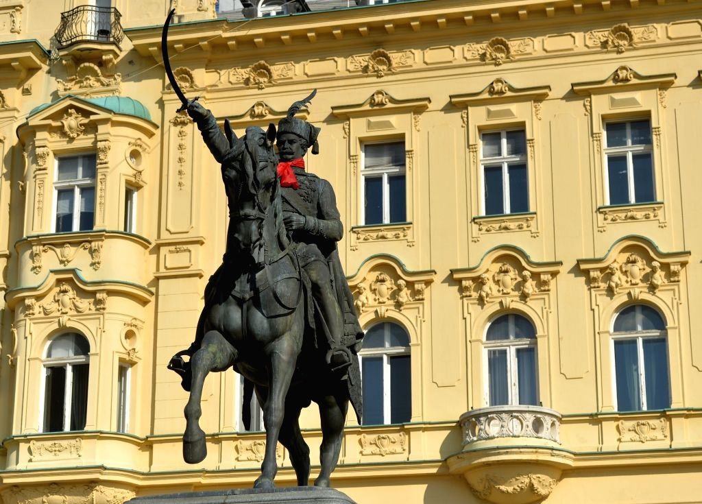 ZAGREB, Oct. 14, 2017 - Statue of Ban Josip Jelacic with a red cravat is seen in Zagreb, Croatia, on Oct. 14, 2017. People celebrate Cravat Day here to commemorate the cravat as a national cultural ...