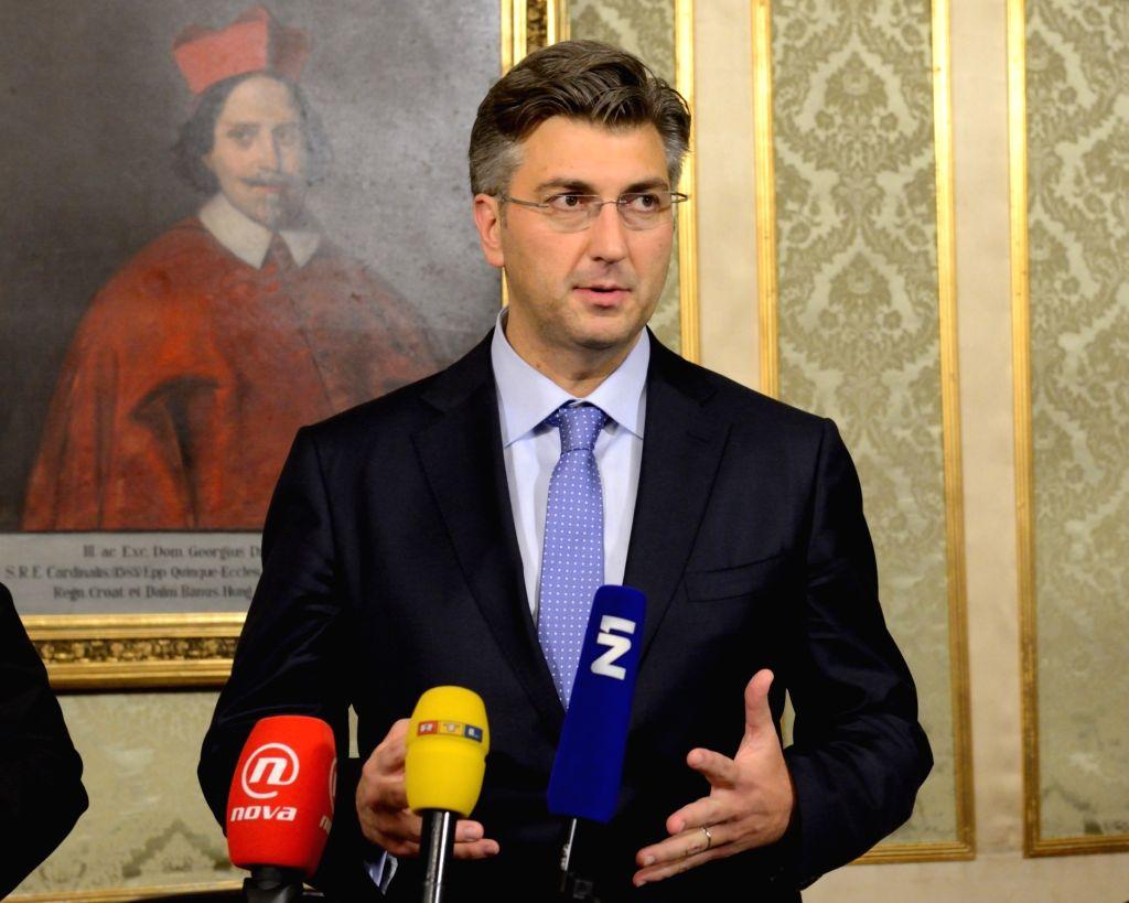 ZAGREB, Oct. 19, 2016 - Croatian new Prime Minister Andrej Plenkovic speaks to the media in Zagreb, capital of Croatia, Oct. 19, 2016. Croatian Parliament approved the new cabinet led by Plenkovic on ... - Andrej Plenkovic