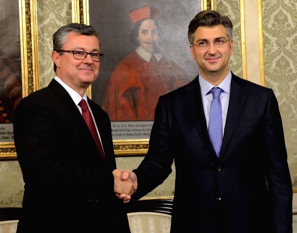 ZAGREB, Oct. 19, 2016 - Croatian new Prime Minister Andrej Plenkovic (R) shake hands with Tihomir Oreskovic, the prime minister of caretaker government in Zagreb, capital of Croatia, Oct. 19, 2016. ... - Andrej Plenkovic