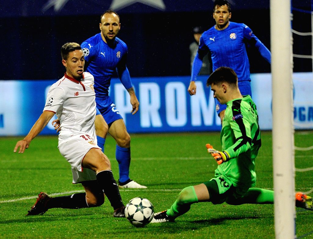 ZAGREB, Oct. 19, 2016 - Samir Nasri of Sevilla FC (1st, L) shoots the ball during the UEFA Champions League Group H match against Dinamo Zagreb at the Maksimir Stadium in Zagreb, Croatia, Oct. 18, ...