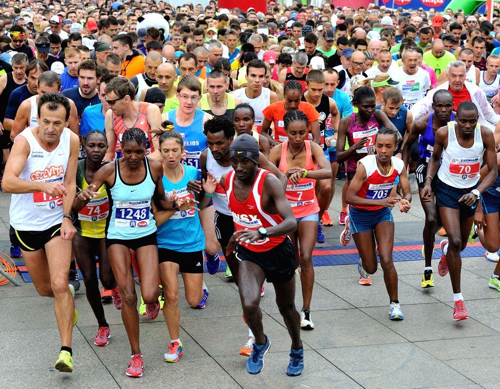 ZAGREB, Oct. 9, 2016 - Athletes start to race during the 25th Zagreb International Marathon race in Zagreb, capital of Croatia, Oct. 9, 2016.