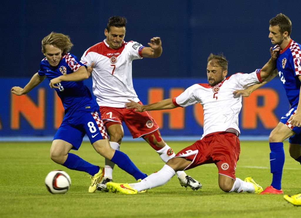 Alen Halilovic (1st, L) of Croatia vies with Clayton Failla (2nd L) of Malta during their Euro 2016 qualifying soccer match in Zagreb, Croatia, Sept. 9, 2014. ...