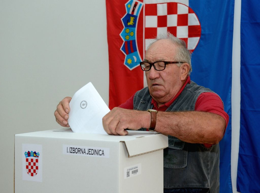 ZAGREB, Sept. 11, 2016 - A Croatian casts his ballot at a polling station in Zagreb, capital of Croatia, Sept. 11, 2016. Nearly 3.8 million eligible voters will elect a 151-seat parliament in an ...