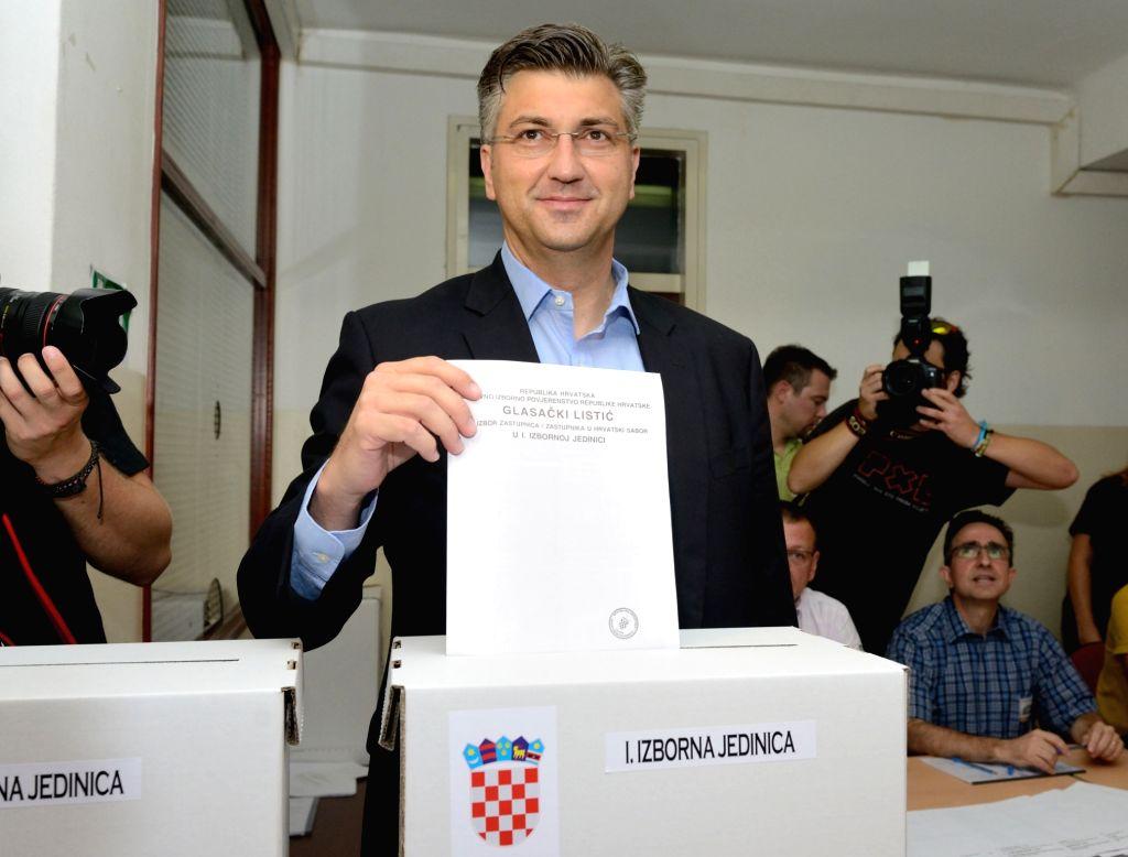 ZAGREB, Sept. 11, 2016 - President of the Croatian Democratic Union (HDZ) Andrej Plenkovic casts his ballot at a polling station in Zagreb, capital of Croatia, Sept. 11, 2016. Nearly 3.8 million ...