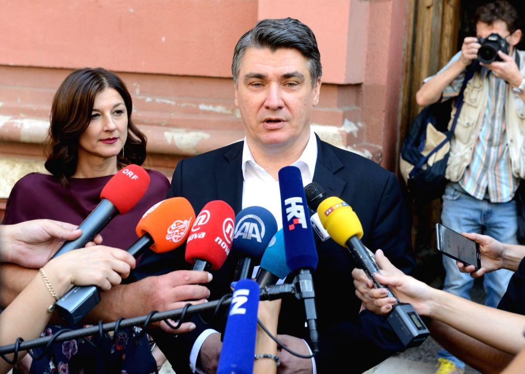 ZAGREB, Sept. 11, 2016 - President of the Croatian Social Democratic Party (SDP) Zoran Milanovic (C) talks to media after voting at a polling station in Zagreb, capital of Croatia, Sept. 11, 2016. ...