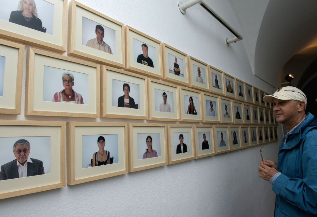 """A visitor views artworks during the Voyage to Europe """"I want to speak about the war"""" exhibition in Klovicevi Dvori Gallery in Zagreb, capital of Croatia, .."""