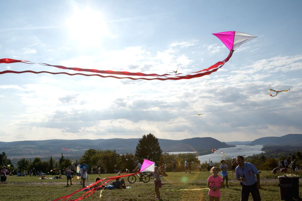 ZEBEGENY, Sept. 16, 2018 - People fly their kites during the Kite Festival in Zebegeny, about 70 kilometres north of capital city Budapest, Hungary on Sept. 15, 2018.